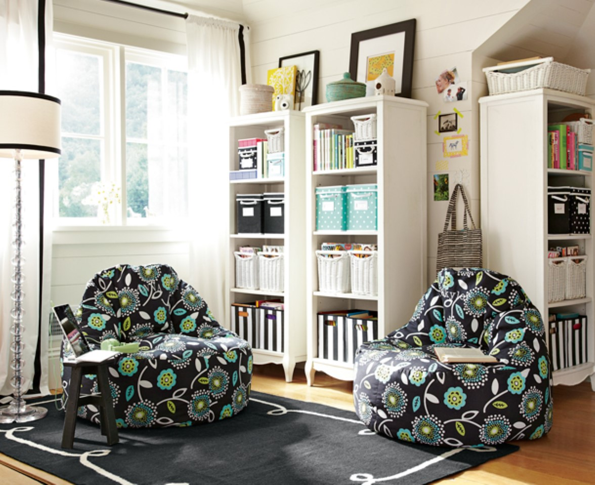 natty-white-shelving-units-paired-with-black-floral-bean-bag-sofas-teen-girl-room-decor-near-windows